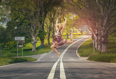 Dancing-Girl-Jumping-In-Street-Looking-Happy